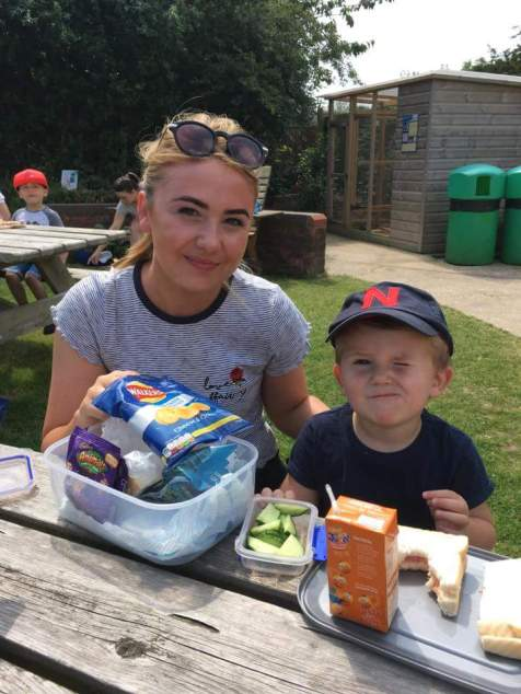 Another parent enjoying a picnic lunch with her son