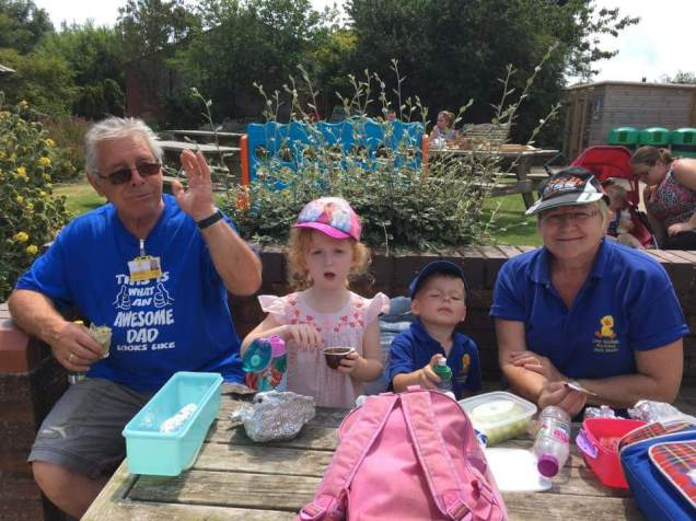 Granny Anne and Grandad Graham with the children enjoying lunch ♡